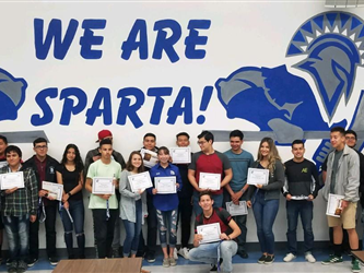 A group of students in front of a We Are Sparta! sign